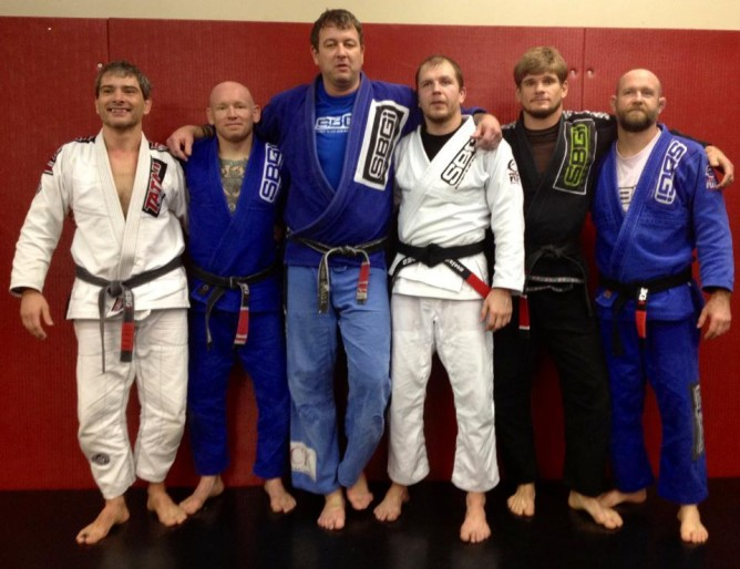 Matt with some of his black belts