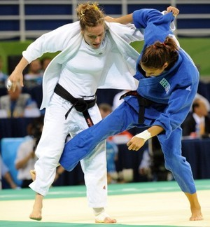 In Judo, women athletes are also required to wear rash guards under the gi.