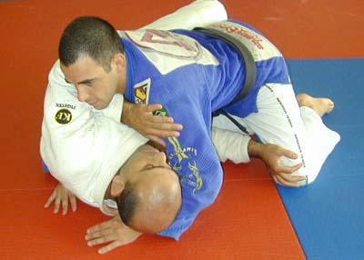 Half guard master Roberto Gordo Correa on the bottom