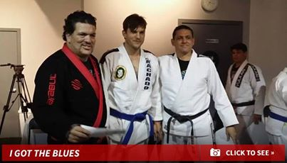 Ashton Kutcher receiving his blue belt from Rigan Machado