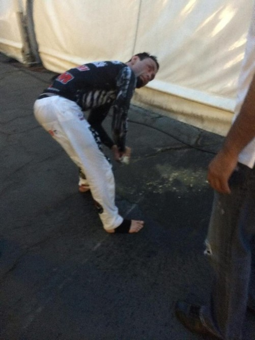 Eddie Bravo vomiting backstage and looking at Royce on his right side
