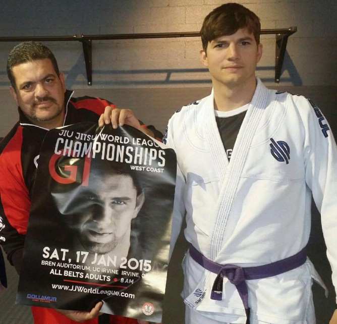 Ashton Kutcher wearing his purple with Rigan Machado