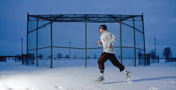 Georges St. Pierre does sprints by himself in the snow at dusk in a park near his St. Isidore home February 2, 2006. St. Pierre has a running routine.