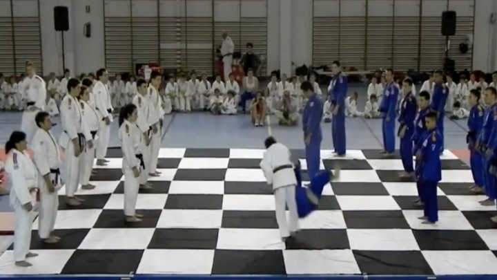 Judokas Throwing Each Other in a Game of Chess On The Mat