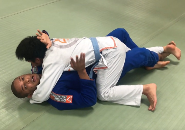 Getting Crushed In Half Guard? Use Your Lockdown To Release Pressure