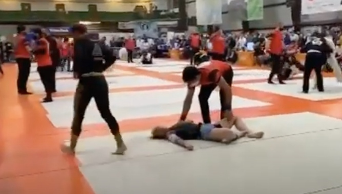 Female BJJ Competitor Goes Out When Caught in Tight Guillotine